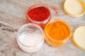 Indian spices in plastic container against marble background Stock Photo