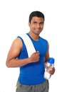 Indian sportsman with water bottle and towel Royalty Free Stock Image
