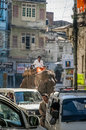 Indian street scene heavy traffic with man riding on elephant on the streets of udaipur rajasthan india Royalty Free Stock Photography
