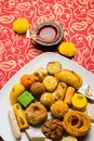 Indian sweets or Mithai for diwali festival with oil lamp or diya and gift box Royalty Free Stock Photo