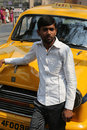 Indian taxi driver posing in front of his cab in kolkata on february the car is hindustan ambassador manufactured since Royalty Free Stock Images