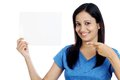 Indian teen showing blank white card smiling Royalty Free Stock Photos