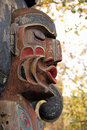 Indian totem pole face Stock Images