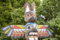 Indian totem wood pole isolated in the forest background Stock Images