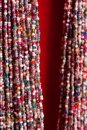 Indian traditional colorful beads glass necklace on red background as asian fashion concept. Royalty Free Stock Photo