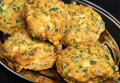 Indian vegetable pakoras made from potato spinach cauliflower and onion Stock Photo