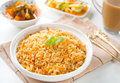 Indian vegetarian biryani rice food curry dhal and milk tea on dining table Stock Photos
