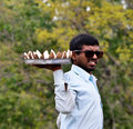 Indian vendor selling coconut on the road Stock Photography