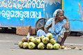 Indian vendor selling coconut on the road Stock Images
