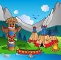Indian village with totem and canoe Royalty Free Stock Photography