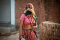 Indian villager woman in veil with dark complexion going summer noon Stock Images