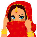 Indian woman covering face beautiful brunette with traditional red sari and hiding her Royalty Free Stock Images