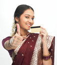 Indian woman with credit card Royalty Free Stock Photography
