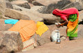 Indian woman drying laundry Stock Images