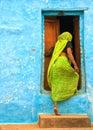 Indian woman entering the door