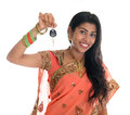 Indian woman holding car key attractive traditional in sari her first own isolated on white background beautiful asian model Royalty Free Stock Image