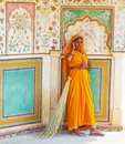 Indian woman inside amber palace near jaipur india amer november of fourt class in brightly colored sari clean the on november in Stock Image