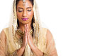 Indian woman praying beautiful with eyes closed on white background Stock Photo