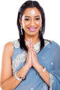 Indian woman praying cheerful young isolated on plain background Stock Photos