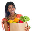 Indian woman in sari dress groceries shopping happy grocery shopper portrait of beautiful traditional holding paper bag full of Stock Photos