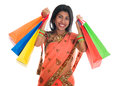 Indian woman in sari dress holding shopping bags portrait of beautiful traditional isolated over white background Stock Images