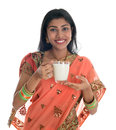 Indian woman in sari drinking milk traditional isolated on white background Stock Photography