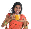 Indian woman in sari drinking orange juice happy traditional a glass of isolated on white background Royalty Free Stock Photo