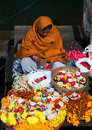 Indian woman selling pooja items in Varanasi, India Royalty Free Stock Photo