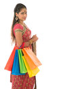 Indian woman shopper portrait of beautiful young in traditional sari dress standing isolated on white background Royalty Free Stock Photos