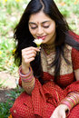 Indian woman smell flowers Stock Photography