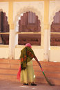 Indian woman sweeping floor mehrangarh fort jodhpur india rajasthan Stock Photo