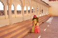 Indian woman sweeping floor mehrangarh fort jodhpur india rajasthan Royalty Free Stock Photo
