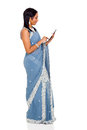 Indian woman tablet computer traditional in sari using Stock Images