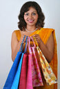 Indian woman in traditional saree with shopping ba Stock Images