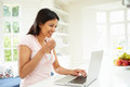 Indian Woman Using Laptop At Home Royalty Free Stock Photo
