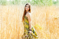 Indian woman walking outdoors in golden field Royalty Free Stock Photo