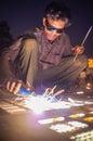 Indian worker welding
