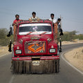 Indian workers in a red truck jaisalmer india march unidentified are transported typical on march jaisalmer india Stock Photo