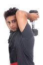 Indian young man doing triceps workout Stock Photo