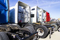 Indianapolis - Circa February 2017: Colorful Semi Tractor Trailer Trucks Lined up for Sale IV Royalty Free Stock Photo