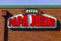 Indianapolis - Circa February 2017: Papa John`s Take-Out Pizza Restaurant IV Royalty Free Stock Photo