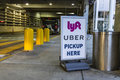 Indianapolis - Circa July 2017: Ride sharing companies Lyft and Uber pickup spot at the airport I Royalty Free Stock Photo