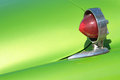 Indicator detail of an old car on a green fender Royalty Free Stock Image