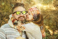 Indie style smiling couple, woman embracing man, hipster outfit, boho chic Royalty Free Stock Photo