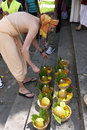 Indien festival ratha yatra at chatelet paris france sunday th of july man preparing offerings for the gods Royalty Free Stock Photo