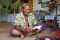 Indigenous Fijian man reads the bible in Fiji Royalty Free Stock Photo