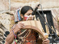 Indigenous Musician Playing Instruments Royalty Free Stock Images