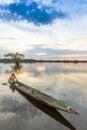 Indigenous people cuyabeno ecuador adult man with canoe on laguna grande national park at sunset model released Stock Photos