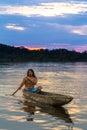 Indigenous people cuyabeno ecuador adult man with canoe on laguna grande national park at sunset model released Stock Image