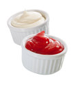 Individual containers of mayo and ketchup small white or ramekins creamy mayonnaise tomato to be served as an accompaniment to a Royalty Free Stock Photos